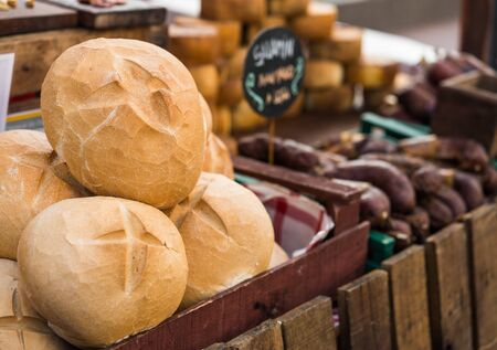 Bread and Italian delicatessen cold meats and cheese at a street food market. Stock Photo