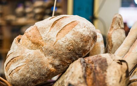 Organic freshly baked baguette bread loaves at a street food market.