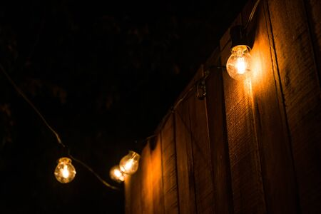 Vintage antique hanging light bulbs at a street food market. Stock Photo