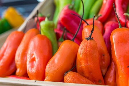 Peruvian aji amarillo chili peppers at a street food market.