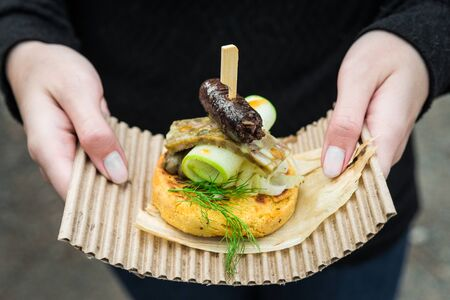 Arepa, Colombian corn patties, with blood sausage, head cheese, and zucchini.