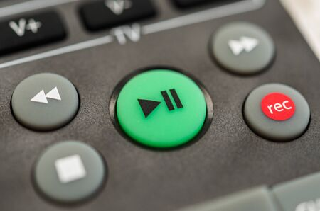 Tv remote control with play button. Concept of entertainment, fun, and news. Stock Photo