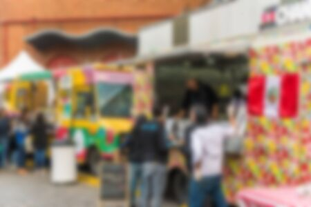 People at a street food market festival on a sunny day. Blurred on purpose. Stock Photo