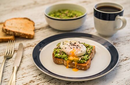 Avocado toast with poached egg. Vegetarian food and healthy eating concept.