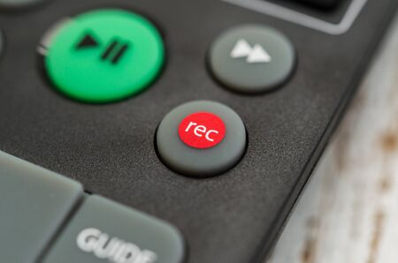 TV remote with recording button. Concept of show business, recording, and radio.