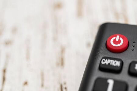 Smart tv remote control with power button. Concept of entertainment, fun, news.