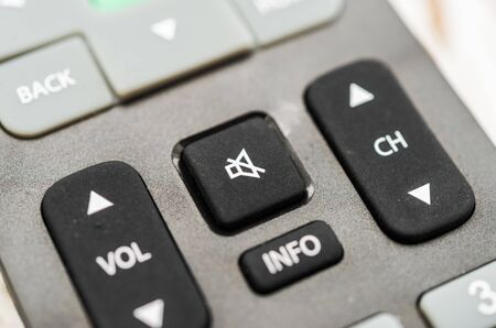Tv remote with volume button. Concept of silence, fake news, and propaganda.