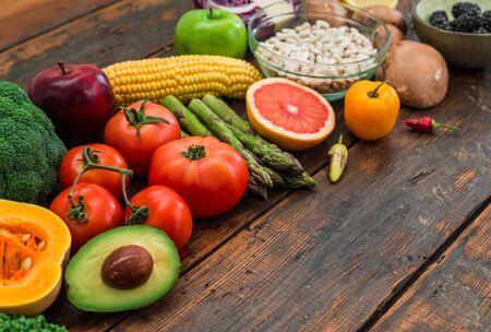 Fresh organic fruit and vegetables, white beans, oatmeal, and blackberries.