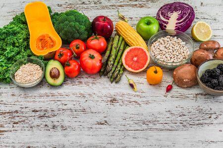 Fresh organic fruit and vegetables, white beans, oatmeal, and blackberries
