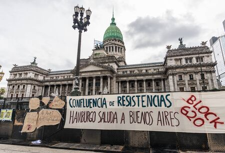 Buenos Aires, Argentina - November 29, 2018: Posters at protests of left-wing