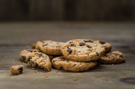Classic chocolate chip cookies against wooden background