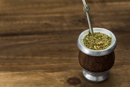 Traditional Argentinian yerba mate tea in a calabash gourd .