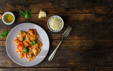 Ravioli stuffed pasta with tomato sauce and basil
