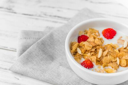 Bowl of breakfast cereals with milk and strawberries 스톡 콘텐츠 - 139729107