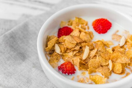 Bowl of breakfast cereals with milk and strawberries. Stok Fotoğraf