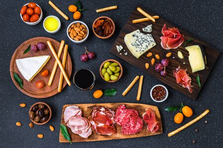 Table of antipasti and appetizers with cold meats and cheese deli platter