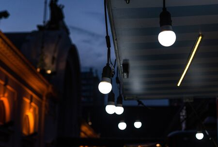 Vintage antique hanging light bulbs at a street food market