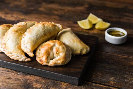 Traditional baked Argentine empanadas savoury pastries with beef stuffing Stock Photo