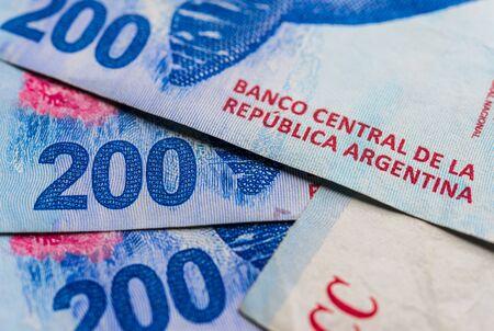 Close up of Argentine money, 200 pesos bills.