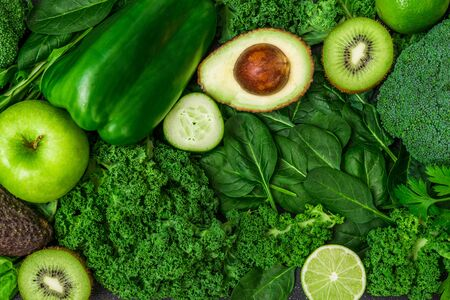 Selection of healthy green food fresh vegetables and fruit Stock Photo