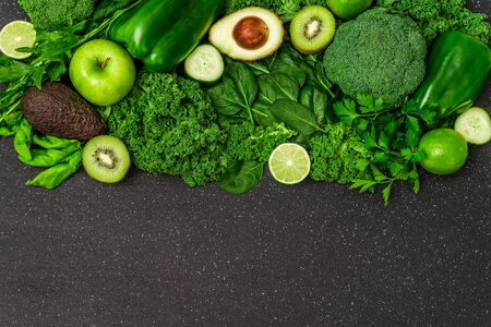 Selection of healthy green food fresh vegetables and fruit. Stock Photo