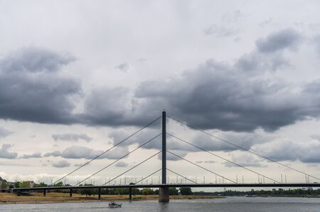 View at Oberkasseler bridge over Rhine river in Dusseldorf, Germany.