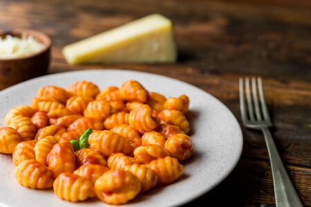 Gnocchi with tomato sauce, basil, and cheese, traditional Italian pasta food. Zdjęcie Seryjne