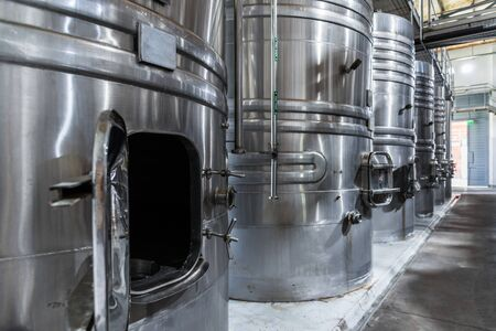 Steel wine tanks for wine fermentation at a winery.