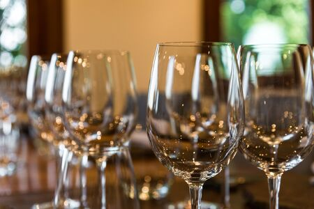 Close up of empty red wine and white wine glasses in the tasting room. Zdjęcie Seryjne