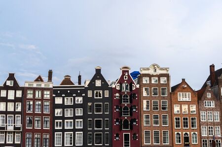 Traditional Dutch colorful houses at Damrak in Amsterdam, Netherlands