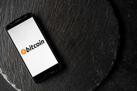 Bitcoin digital cryptocurrency money on the screen of a smartphone.