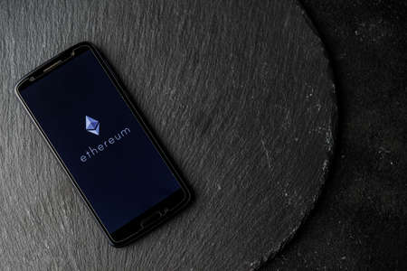 Ethereum blockchain money cryptocurrency on screen of smartphone. 免版税图像