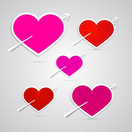 pierced: Vector paper red, pink hearts pierced with arrows
