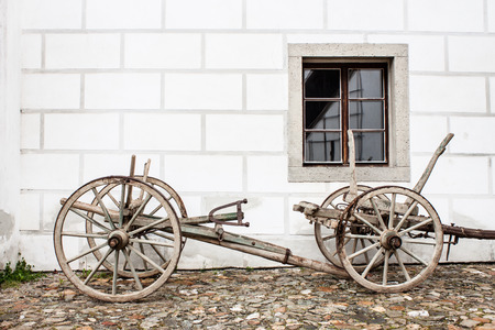 tillage: Vintage Old Wooden Ploughe with Renaissance Sgrafito Wall on Background Photo