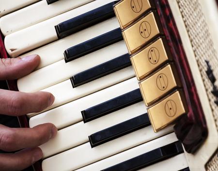 Fingers Playing Accordion Keys. Retro Photo.