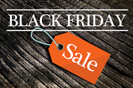 Black Friday Sale Text on Dark Wood Background Stock Photo