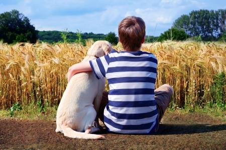 retriever: Boy with pet dog