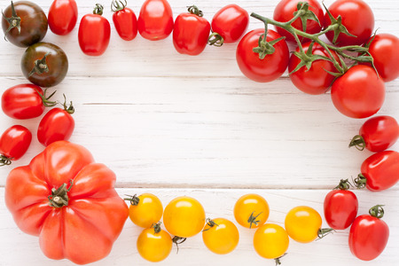 Frame made of colorful tomatoes photo