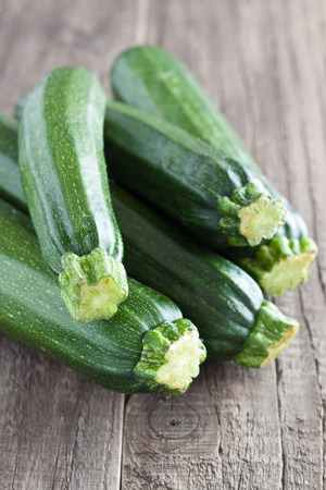 Zucchini on a wooden table Stock Photo