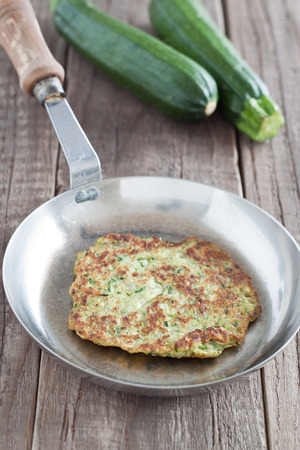 fritter: Zucchini fritter in a pan
