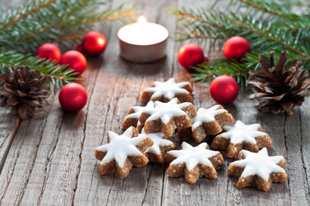 Christmas cookies and candle with festive decoration photo