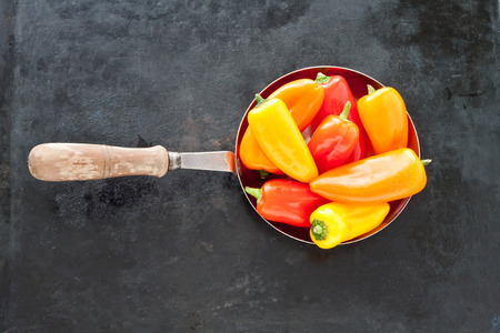 baking tray: Colorful mini paprika on an old baking tray Stock Photo