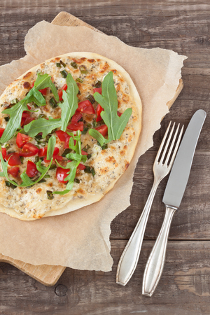 alsatian: Tarte flambee, an alsatian pizza, with tomatoes and arugula