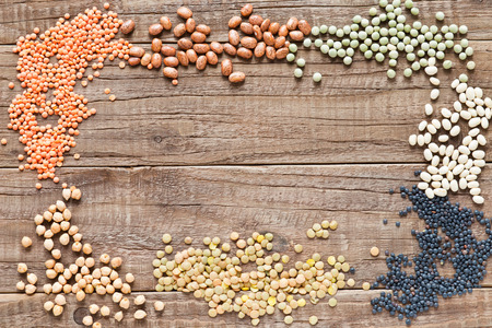 legumes: Frame of various dried legumes on a wooden table