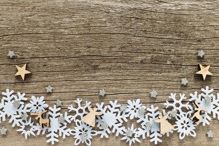 Christmas background  with white snowflakes and wooden figures