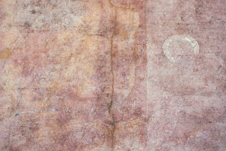 Antique, medieval pink plaster wall surface. Very old colorful wall texture with a crack. Abstract pink orange background.