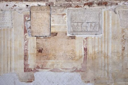 Abstract antique wall background. Ornamental, decorative layers. Weathered ornate elements on old medieval wall surface. Obsolete design. Past times pattern. Imagens