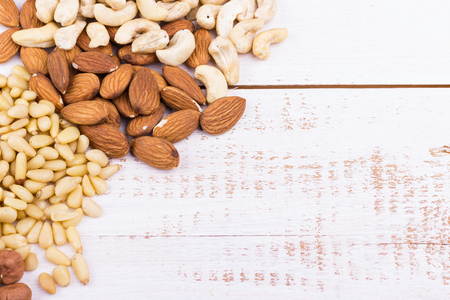 Nut mix. Walnuts, almonds,pine nuts,hazelnuts,cashews on white background. Selective focus. Stock Photo
