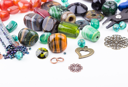 Semi-precious stone beads, crystals, glass beads, metal components and seedbeads for making jewelry. Selective focus.