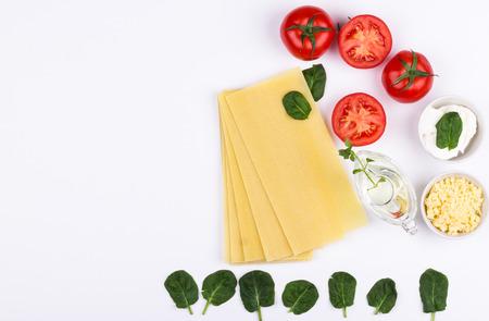 Spinach lasagne ingredients on white background. Flat lay composition Standard-Bild